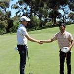 Corey Fawkes congratulates club champion Chantha Kong